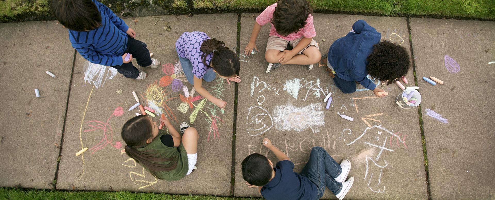 Kids play together on neighborhood sidewalk afterschool